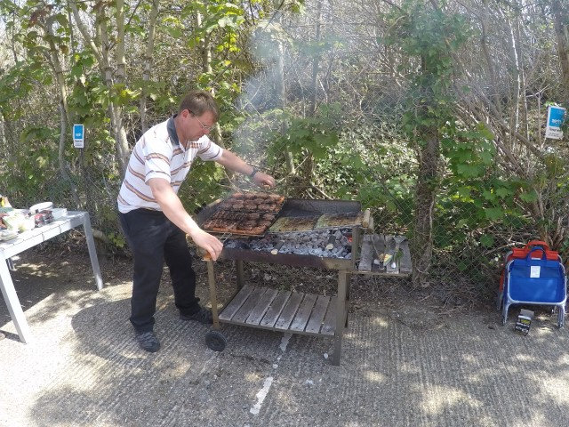 Colin crisping up the sausages!